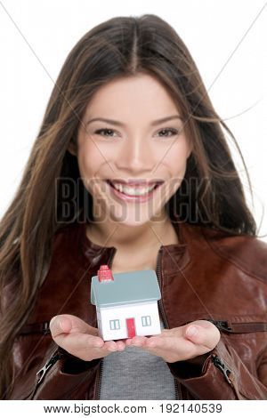 Mortgage, home insurance new house owner care concept Happy young first time homeowner buying new house. Real estate agent woman showing small toy model on hands.