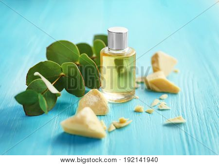 Beautiful composition with ingredients for cocoa butter lotion on table