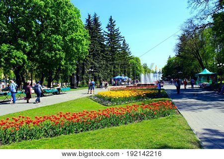 Chernihiv / Ukraine. 06 May 2017: people have a rest in the city park with beds of tulips in the spring. 06 May 2017 in Chernihiv / Ukraine.