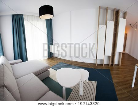 Cozy and bright living room with sofa and furniture