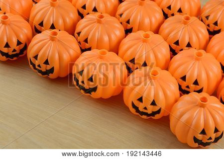 Plastic jack o' lantern Halloween decorations lined up in rows