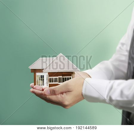 Home insurance concept in a hand