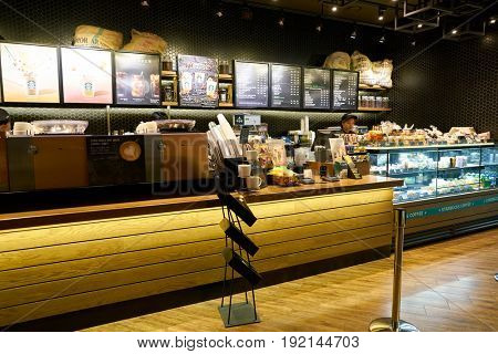 SEOUL, SOUTH KOREA - CIRCA MAY, 2017: inside Starbucks in Seoul. Starbucks Corporation is an American coffee company and coffeehouse chain.