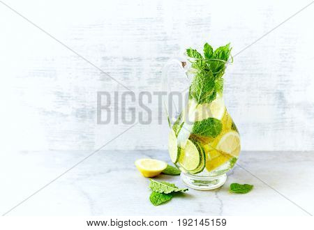 Lime, lemon  and mint infused water in a jug