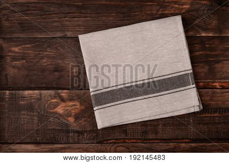 Top view of linen napkin on dark wooden table