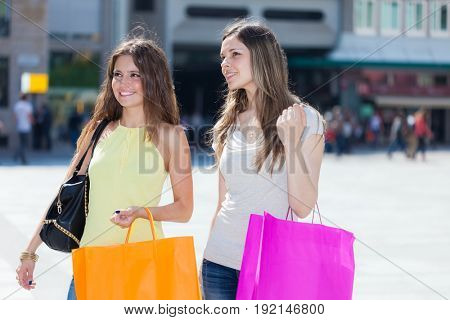 Portrait of two friends shopping together