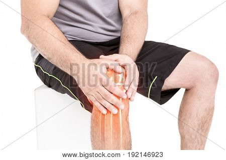 Digitally generated image of man suffering with knee inflammation against white background