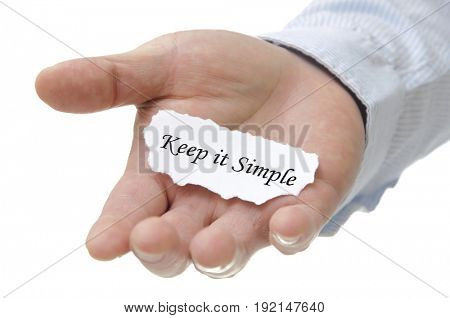 Business man holding keep it simple note on hand