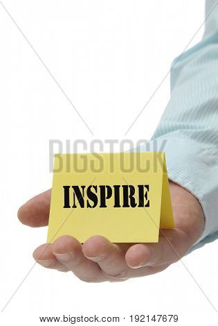 Business man holding yellow inspire sign on hand