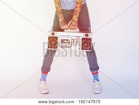 People woman holding stereo radio on the white background