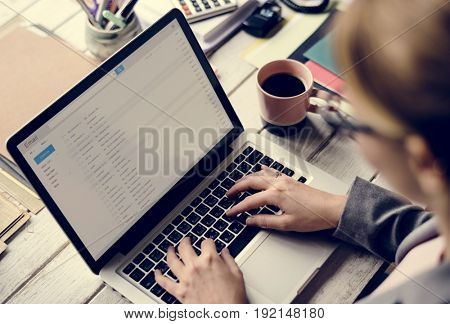 Businesswoman Checking E-mail Online on Laptop