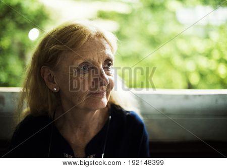 Senior woman staring on something