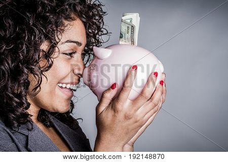 Beautiful black woman saving money