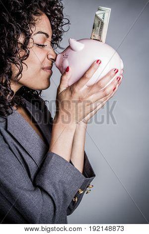 Business woman holding piggy bank money