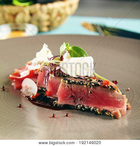 Restaurant Food - Delicious Fried Tuna Fillet with Sesame outside. Gourmet Restaurant. Delicious Dish