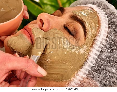 Collagen face mask. Facial skin treatment. Elderly woman 50-60 years old receiving cosmetic procedure in beauty salon. Professional beautician removing wrinkles. Therapeutic mud for home masks.