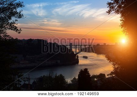 View of Douro river from Jardins do Palacio de Cristal at sunset, Porto, Portugal.