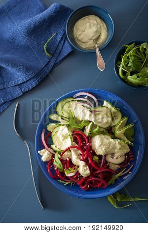 spiralized beet and cucumber salad with avocado dressing, healthy vegan meal