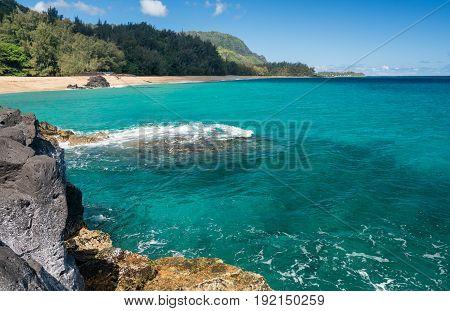 Rocks frame the turquoise ocean off Lumahai Beach in Kauai in Hawaiian islands