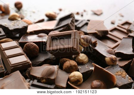 Heap of broken chocolate pieces on table