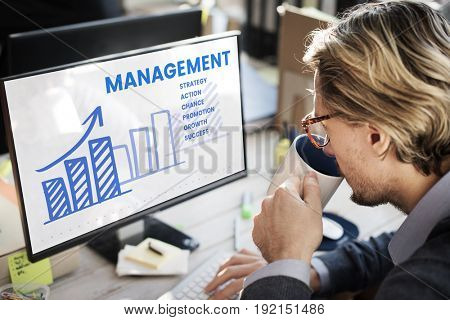 Businessman working on computer network graphic overlay