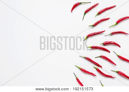 red chili pepper or paprika on white table background top view space for text
