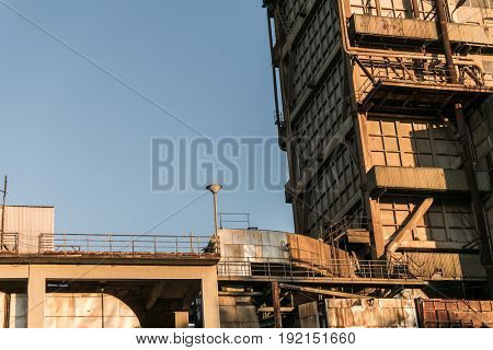 Abandoned factory building, rusty old construction.