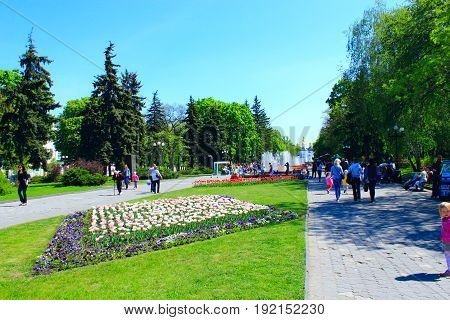 Chernihiv / Ukraine. 06 May 2017:people have a rest in the city park with beds of tulips in the spring. 06 May 2017 in Chernihiv / Ukraine.