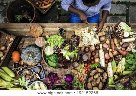 People prepare a fresh vegetable