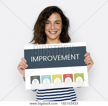 Woman holding improvement board