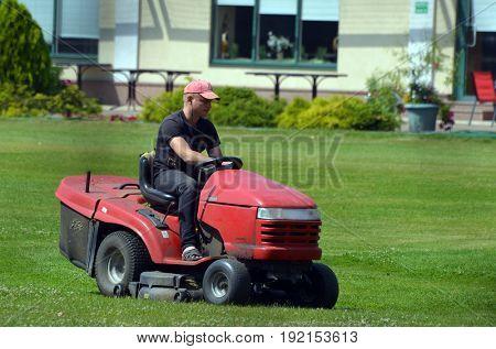 Lawn mower.Golf Center of Kiev.June 21 ,2017 in Kiev, Ukraine