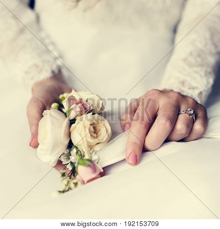 Attractive Beautiful Bride Showing Engagement Wedding Ring on Hand and Flower Bouquet