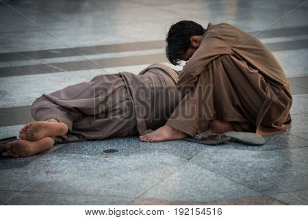 Two poor men on the street sleeping