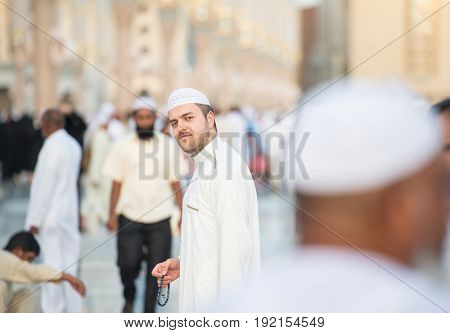 Muslim man enjoying his visit to holy mosque