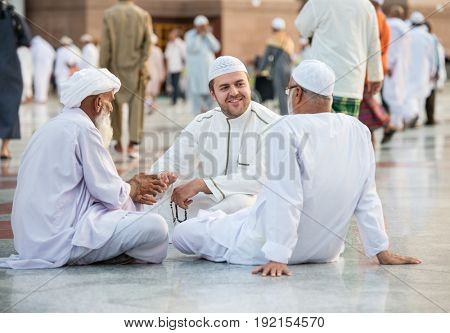 Small group of men sitting and talking