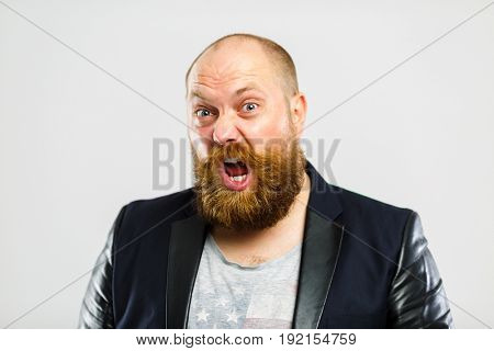 Screaming brutal man with beard