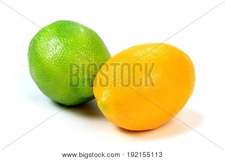 Closeup shot of green and yellow lemons isolated on white background