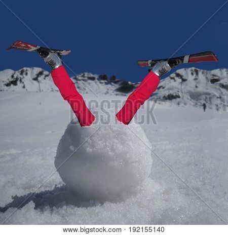 Skier trapped in a snow ball.