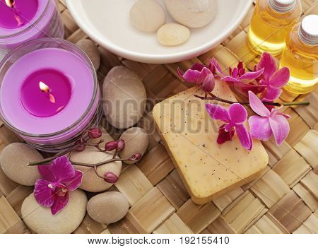 soap, cosmetic bottles, aromatherapy candles and orchid flowers