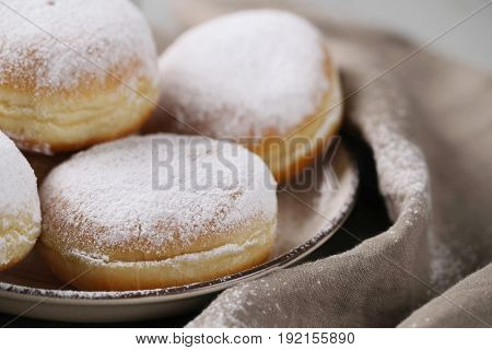 Delicious doughnuts on the table