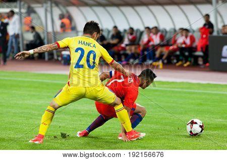 CLUJ-NAPOCA, ROMANIA - 13 JUNE 2017:Sergiu Hanca (L) of Romania fights the ball with Alexis Sanchez of Chile during the Romania vs Chile friendly, Cluj-Napoca, Romania - 13 June 2017
