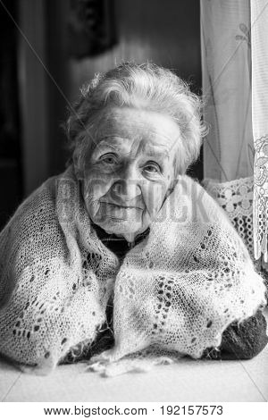 An elderly woman, black and white portrait.