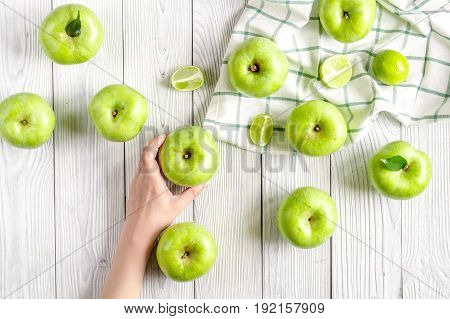 Organic fruits with green apples design on white desk background top view