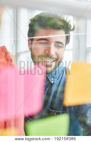 Man as entrepreneur gathering ideas on notes for a new strategy