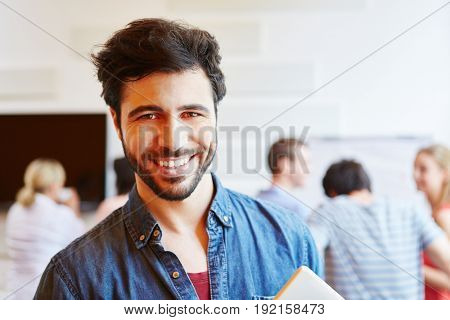 Young student smiling content in a start-up company
