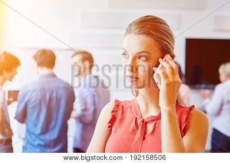 Young blond woman using smartphone for communication