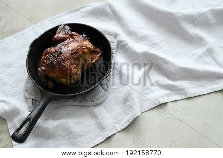 Fried chicken on a frying pan