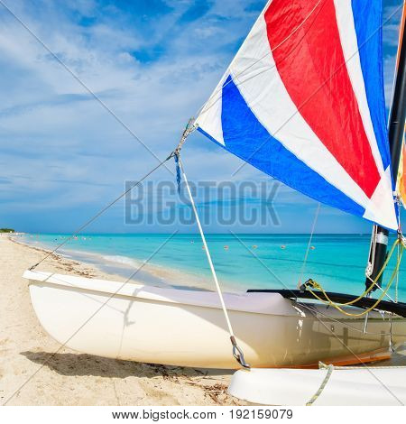 Colorful sailboat at the tropical Varadero beach in Cuba on a summer day
