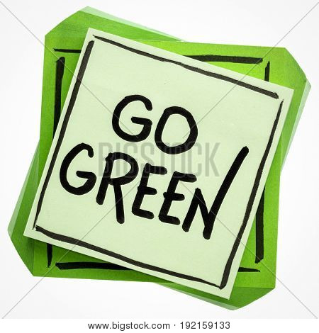 go green reminder - handwriting on an isolated sticky note