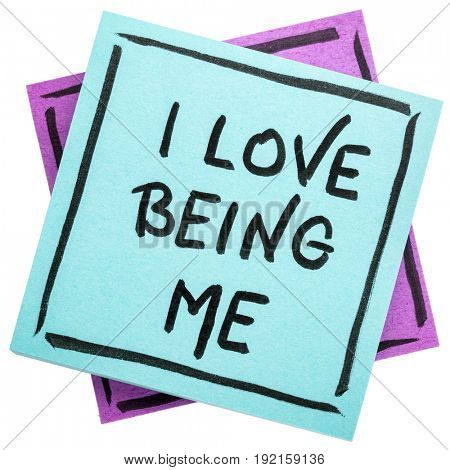 I love being me - positive affirmation - handwriting on an isolated sticky note